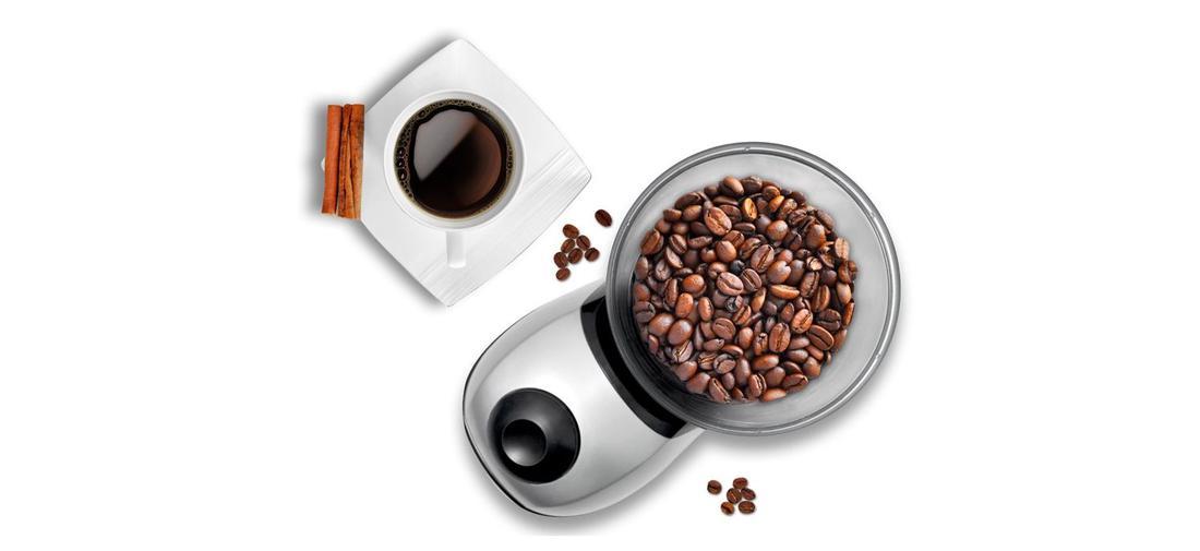 ziarna kawy w młynku Eldom MK150 i kawa w filiżance