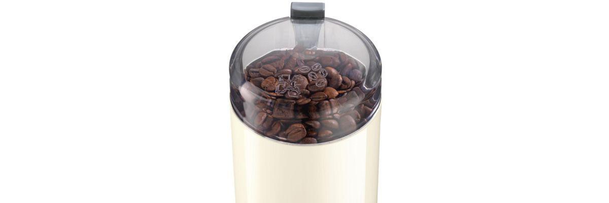 ziarna kawy pod pokrywką w młynku Bosch