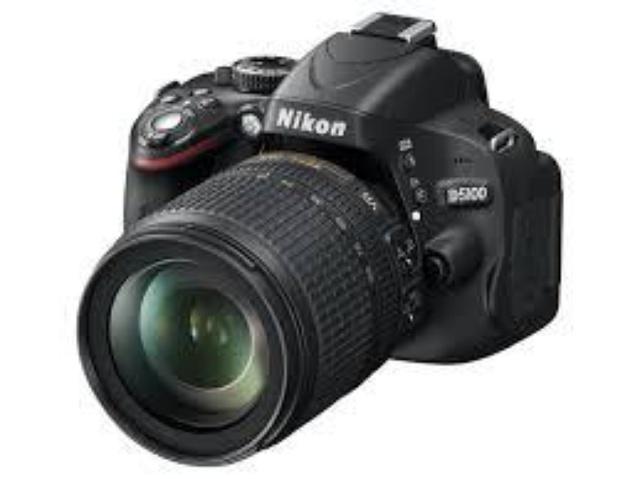 Nikon D5100 + 18-105 VR