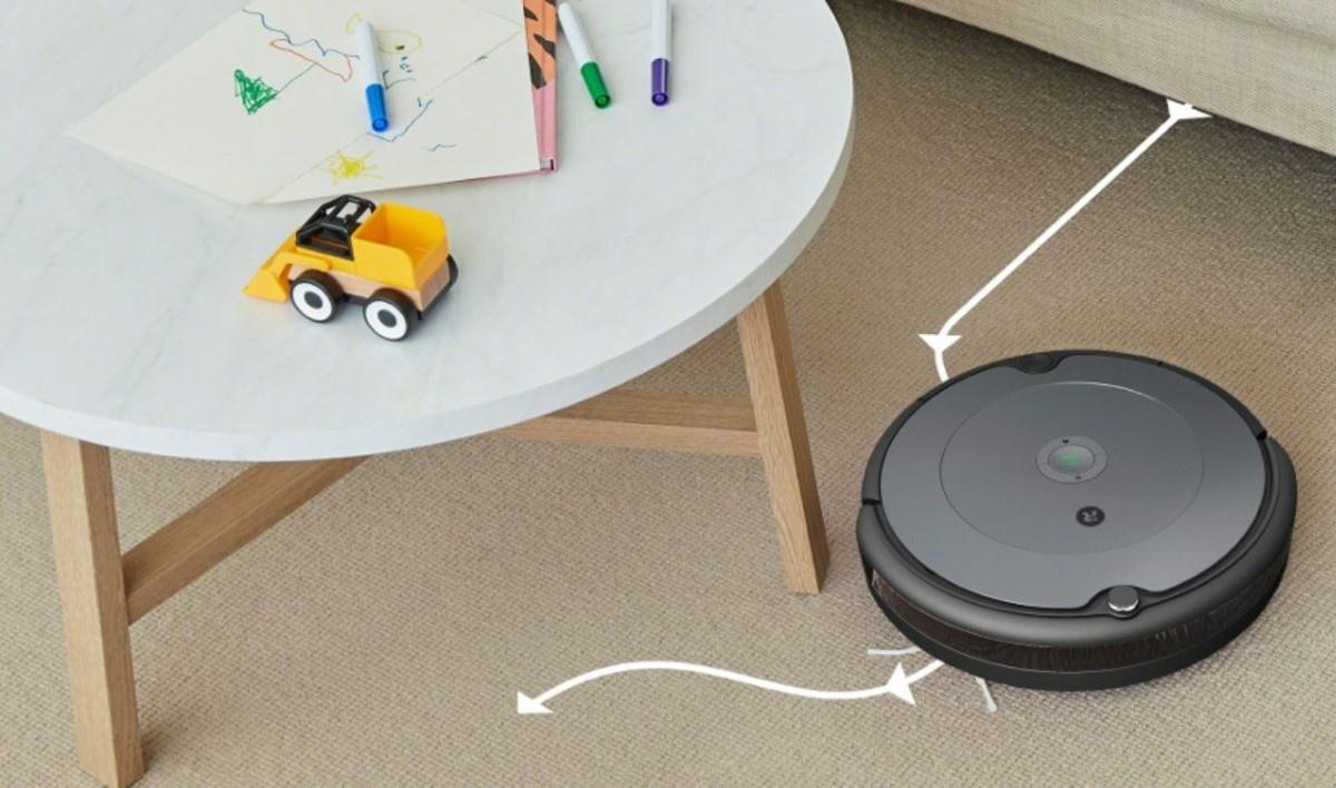 iRobot Roomba 697 na dywanie