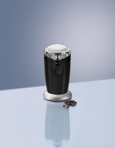 elektryczny młynek do kawy Clatronic KSW 3306 i kilka ziaren kawy